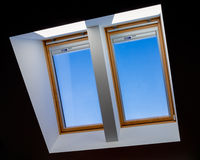 double roof windows overlooking the blue sky