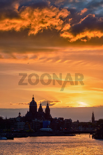 Amsterdam cityscape skyline with  Church of Saint Nicholas on su