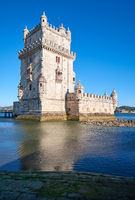 Belem Tower on river Tagus in Lisbon with reflection in water on blue sky background, Portugal