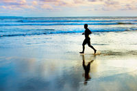 Running at the ocean beach