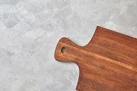 wooden kitchen board on a gray concrete background