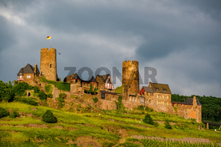 Thurant Castle and vineyards above Moselle river near Alken, Germany.