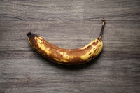 overrripe banana with brown skin