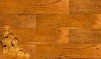 Old wooden planks with gold coins background