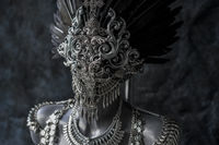 Steampunk, handmade piece, silver jewelry costume with chains and coins. wears a headdress made with feathers and gothic pieces
