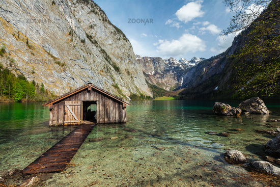 Boat shed dock on Obersee lake. Bavaria, Germany