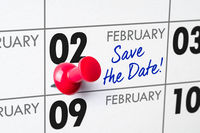 Wall calendar with a red pin - February 02