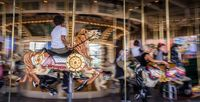 Kid on horse on old french carousel