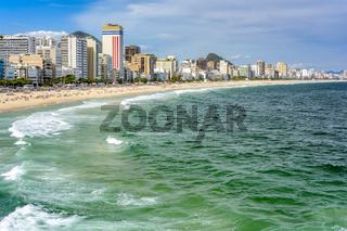 Leblon beach, sand and city
