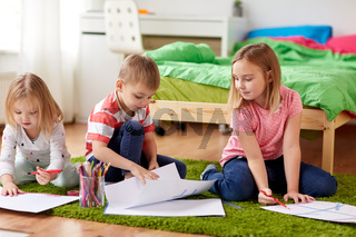 happy creative kids drawing at home