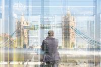 British businessman talking on mobile phone in London city, UK.