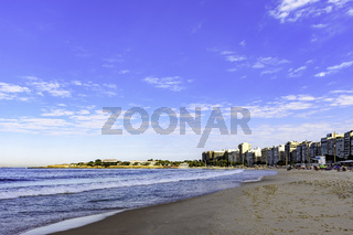 Copacabana beach with sea, buildings and fortress