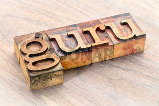 guru word abstract in wood type