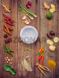 Various of Thai food Cooking ingredients and spice red curry paste ingredient of thai popular food on rustic wooden background. Spices ingredients chilli ,pepper, garlic and Kaffir lime leaves .