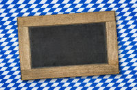 Empty chalkboard on a bavarian diamond pattern