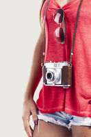 Woman with a old vintage camera