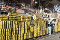 Packs of sugar cane sticks sold in the market in the city of Banos