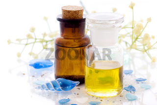Two glass flakons with massage oil as closeup on white background