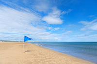 Blue flag on Gruissan plage in France