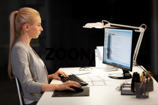 female programmer working late at night office