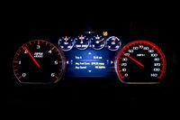 Modern light car mileage on black background Avr speed