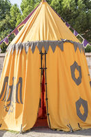 medieval tent of different colors with coats of arms and blazons of noble houses