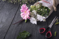 Wrapped flowers and scissors