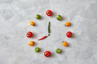 Watches made from vegetables of tomatoes and Brussels sprouts