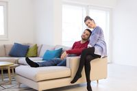 couple hugging and relaxing on sofa