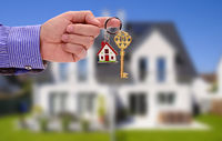 key in hand of real estate agent as offer for your new home