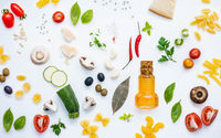 Italian food concept .Various kind of pasta with ingredients sweet basil ,tomato ,garlic ,parsley ,pine nut,pepper ,champignon ,zucchini and parmesan cheese on white wooden background flat lay.
