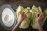 Dropping salt leaves Chinese cabbage to cook kimchi on slate