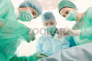 Surgeons and medical assistant operating