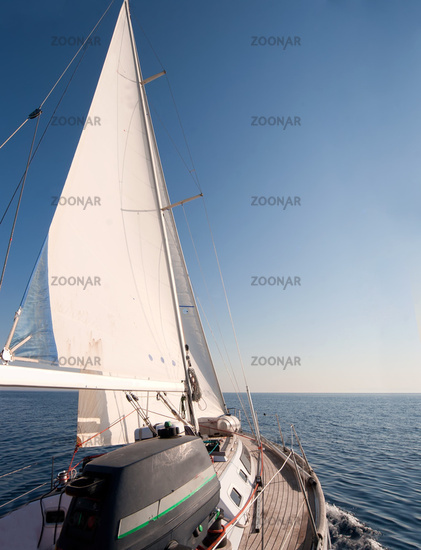 Yacht sailing in the sea, clear blue sky