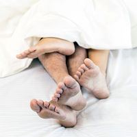 young sexy couples in bed