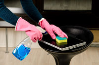 Wiping the laptop cover with a sponge and cleaning liquid