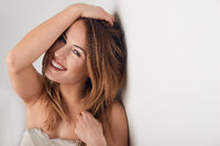 Smiling beautiful young woman with long hair