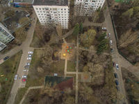 Aerial shot of apartment blocks with yard in Moscow