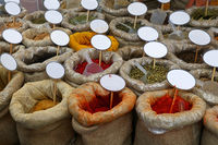 Close up bags of spices with blank price tags