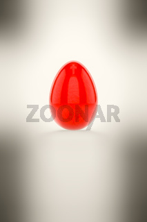 a red easter egg on white background