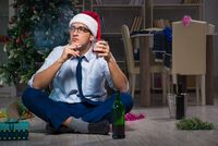 Businessman celebrating christmas at home alone