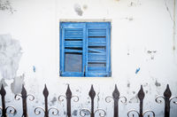 old blue greek shutter and fence