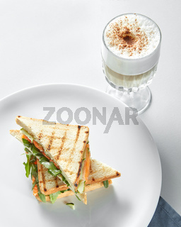 Breakfast concept - cup of coffee with toasts