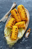 Cobs sweet corn grilled with sea salt.