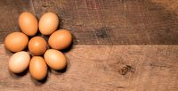 Pattern of eggs on rustic wooden table for Easter