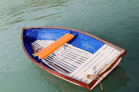 Old wooden boat on the lake - rowboat