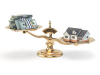 Scales with house and money. Real estate investments concept.