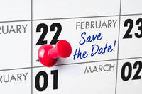 Wall calendar with a red pin - February 22