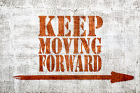 Keep moving forward -  graffiti on stucco wall