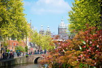 Bridge, canal and St. Nicolas Church in Amsterdam